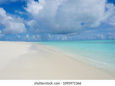Beautiful beach shot with the sky and sand in view.