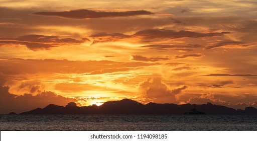 Beautiful beach sunset with big clouds and golden light sky  background