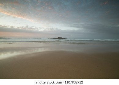Beautiful beach at sunset in Galicia, Spain.