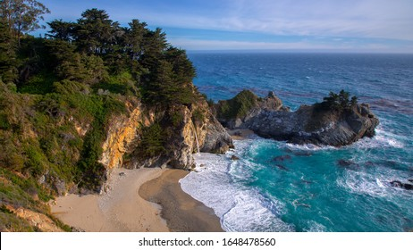 Beautiful Beach and Sunset at McWay Falls at Julia Pfeiffer Burns State Park Big Sur California, USA