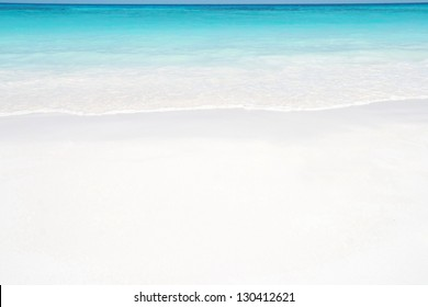 beautiful beach surface texture background ,travel landscape clean white sand and blue sea water wave ripple in beautiful ocean and natural sandy island