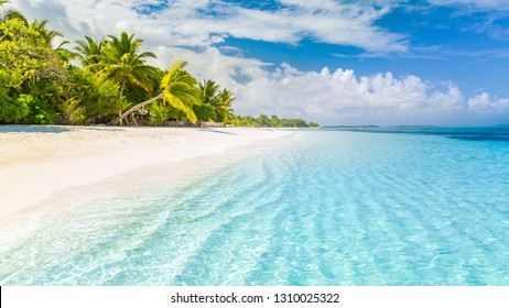 Beautiful beach. Tropical beach background as summer landscape, white sand and calm sea for beach banner. Perfect beach scene vacation and summer holiday concept. Boost up color process