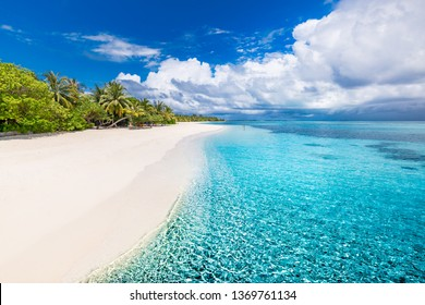 Beautiful beach and tropical sea. Wonderful beach nature, Maldives scenery, perfect view of exotic landscape, white sand and blue sky. Luxury resort background for summer vacation and holiday template