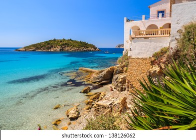 Beautiful beach turquoise sea water white holiday house, Sant Elm, Mallorca island, Spain