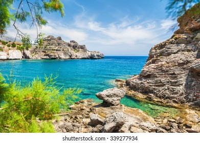 Beautiful beach with turquoise water and cliffs. Crete island, Greece.