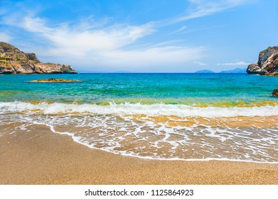 Beautiful beach with turquoise water and sand in Agios Pavlos, Crete, Greece.
