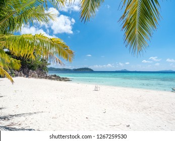 Beautiful beach, view of nice tropical beach with palms around. Holiday and vacation concept with white sand. Philippines, November, 2018
