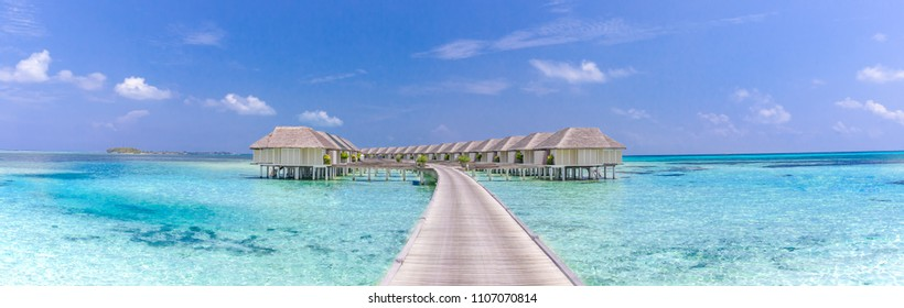 Beautiful beach with water bungalows at Maldives. Perfect beach panorama for summer travel destination banner background