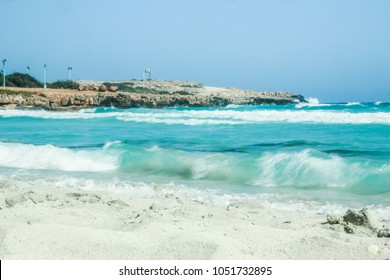 beautiful beach with waves in the nature of the background