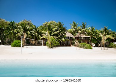 Beautiful beach with white sand at tropical Olhuveli island, south Male Atoll, Maldives.
