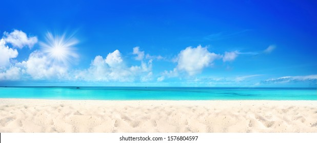 Beautiful beach with white sand, turquoise ocean water and blue sky with clouds in sunny day. Panoramic view. Natural background for summer vacation - Shutterstock ID 1576804597