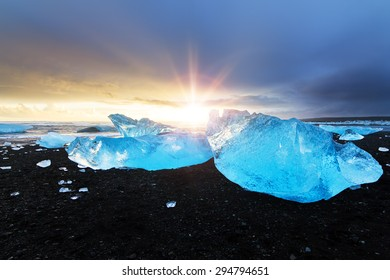 Beautiful beached chunks of ice at the beach at Jokulsarlon, Iceland, at sunset in winter