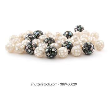 Beautiful beads from Abalon Haliotis natural gemstone on white background.