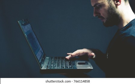 beautiful bearded man with a laptop