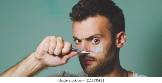 beautiful bearded man with a toothbrush