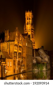 The beautiful Belgian city of Bruges by night reflected in the water