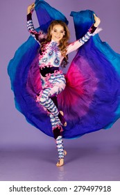 Beautiful belly dancer girl is wearing a colorful fashion costume.