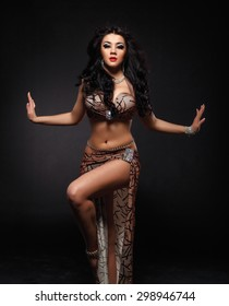 Beautiful belly dancer in the studio