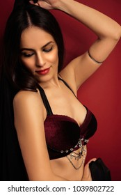Beautiful belly dancer young woman in gorgeous red costume dress