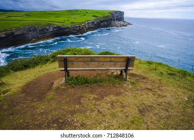 Beautiful bench on the edge of the cliff