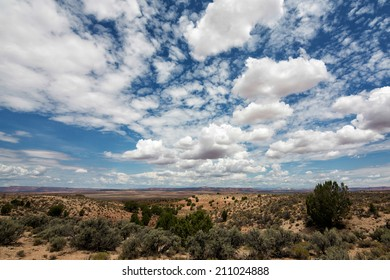 Beautiful  big blue sky with numerous clouds in the desert on the border of Utah and Arizona