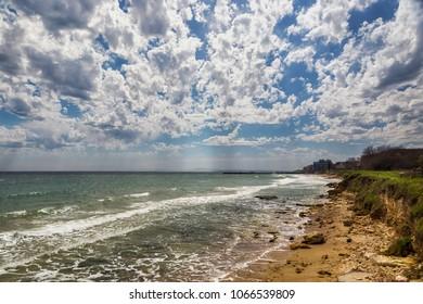 Beautiful big blue sky, seascape, sun, clouds. A vast space, freedom, great outdoors