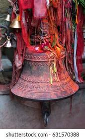 Beautiful big bronze bell with sacred carvings in a hindu temple in Kathmandu, Nepal