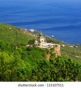 Beautiful big church on the hill in front of the sea