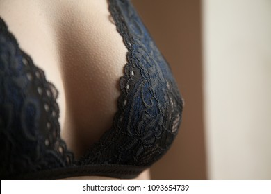Beautiful big female breasts in a bra, sexy boobs. Advertisement of a lingerie.