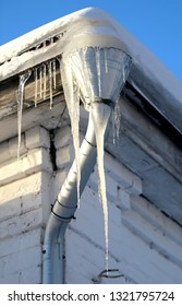 Beautiful big icicles hanging on the building take a close-up picture