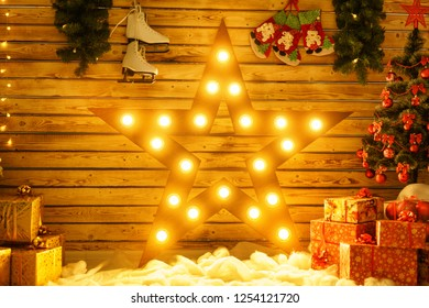 beautiful big star stands against the wall and glows, glowing Christmas decor.