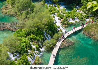 Beautiful big waterfall background in Plitvice national park at spring time.Famous tourism location of waterfall in Europe,Croatia.Landmark of the world.blurred tourists group.High angle view.