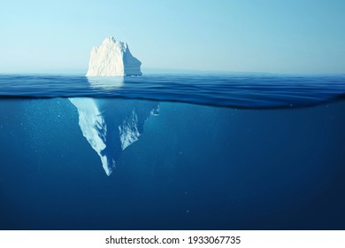 Beautiful big white iceberg underwater. Global warming and melting glaciers, concept. Iceberg in the ocean with a view under water. Crystal clear water. Hidden Danger And Global Warming