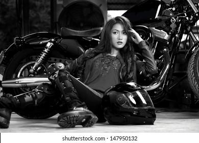 Beautiful Biker in studio shot.