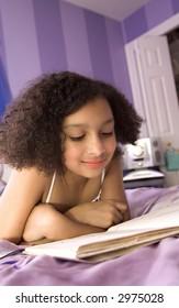 beautiful biracial child reading a book