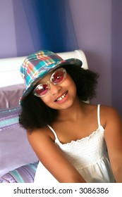 Beautiful biracial girl with hat and sunglasses