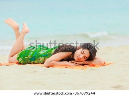 Black teen girls lying down on stomach
