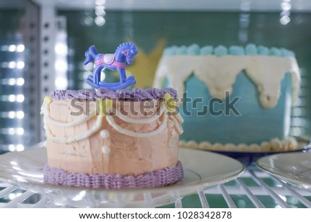 Beautiful Birthday Cake Displayed In The Fridge Pink Is Decorated With Rocking Horse