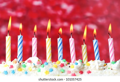 beautiful birthday candles  on red background