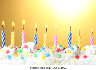 beautiful birthday candles  on yellow background