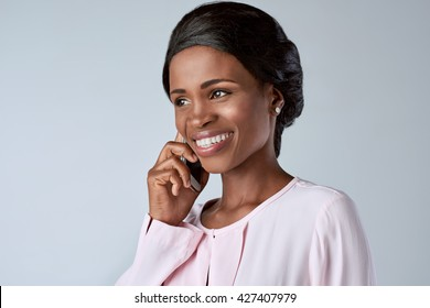 beautiful black african woman talking smiling on her mobile cell phone smartphone