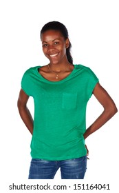 Beautiful black african young adult woman casually dressed in an emerald green t-shirt and Blue jeans and with her hair slicked back into a ponytail and isolated on a white background