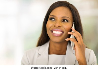 beautiful black businesswoman talking on mobile phone
