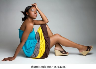 Beautiful black fashion woman sitting
