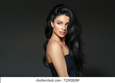 Beautiful Black hair woman beautiful portrait. Hairstyle curly hair beauty female model girl over dark background
