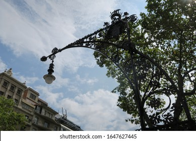 Beautiful black iron street lamp in the streets of Barcelona in Spain