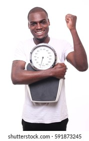 Beautiful black man with a scale