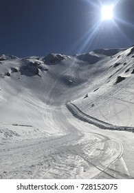 Beautiful black ski run slope Joue the Loup blue sky with sun