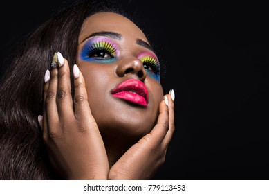 Beautiful black skin woman with fantasy bright makeup