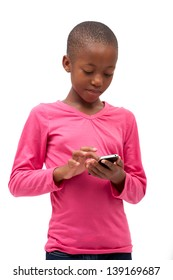beautiful black south african girl concentrating hard while sending a sms on the cell phone